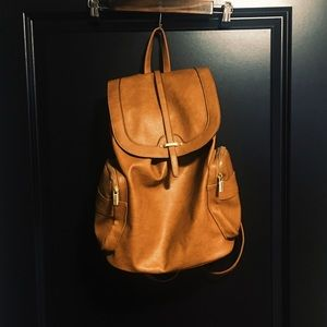 Light Brown Leather Backpack with Gold Accents